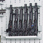 6-Capacity Stock Shelf On Expandable Weapon Rack With Firearms