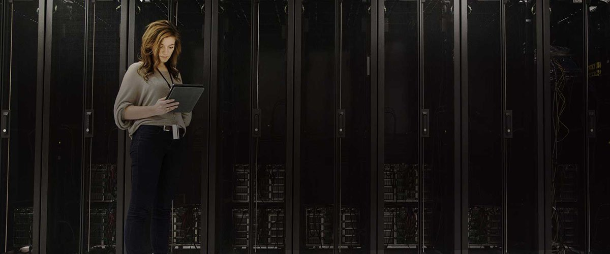Secure Media Storage Banner - Woman In Server Room